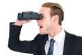 Surprised businessman looking through binoculars Royalty Free Stock Photo