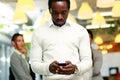 Surprised businessman using smartphone Royalty Free Stock Photo