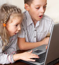 Surprised child with laptop Royalty Free Stock Photography