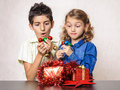 Surprised children christmas present decorations amazed looking at and Stock Image