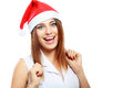 Surprised christmas woman happy wearing a santa hat smiling isolated over a white background Stock Photos