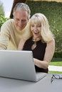 Surprised Couple Using Laptop Royalty Free Stock Image