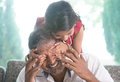 Surprised daddy happy indian family at home asian girl surprising her father by covering eyes parent and child indoor lifestyle Royalty Free Stock Images