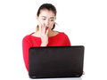 Surprised and disgusted woman working on laptop Royalty Free Stock Images
