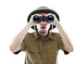 Surprised explorer looking through binoculars Royalty Free Stock Photography
