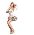 Fashion model girl dressed in short chiffon beige dress