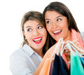 Surprised female shoppers holding bags isolated over white background Royalty Free Stock Photography