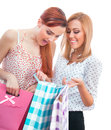 Surprised friends women holding shopping bags isolated on white background Stock Photography