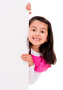 Surprised girl with banner a isolated over a white background Royalty Free Stock Photos