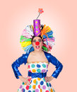 Surprised girl clown with a big colorful wig Stock Photography