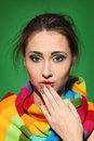 Surprised girl in a colorful scarf Royalty Free Stock Images