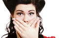Surprised girl covering her mouth by the hands close up portrait of attractive pinup over white background Royalty Free Stock Photography