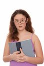 Surprised girl holds a  textbook. Royalty Free Stock Images