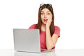 Surprised girl with laptop Royalty Free Stock Photo