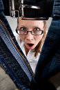 Surprised girl looking inside unzipped pants Royalty Free Stock Photo