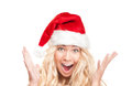 Surprised girl in red santa hat isolated on white. Stock Images