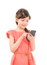Surprised girl texting on her mobile phone wondering little cute in red dress with an interesting information smartphone isolated Stock Photos