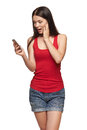 Surprised happy woman reading a sms on cell phone isolated on white background Royalty Free Stock Photo