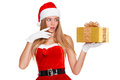 Surprised happy young woman in santa claus clothes looking on christmas gift in excitement isolated over white background Royalty Free Stock Photography