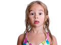 Surprised little blond girl with wet hair Royalty Free Stock Photo