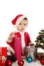 Surprised little santa girl over the white Royalty Free Stock Images