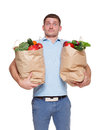 Surprised man hold bags with healthy food, grocery buyer isolated Royalty Free Stock Photo