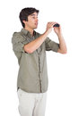Surprised man holding binoculars on a white background Stock Image