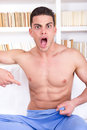Surprised man pointing a finger down to the groin half naked Royalty Free Stock Photo