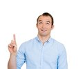Surprised man pointing up Stock Images
