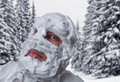 Surprised man with shaving foam on his head strange face and over in winter forest Royalty Free Stock Image