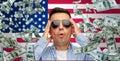 Surprised man under money rain over american flag