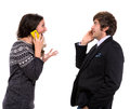Surprised man and woman with cell phones men women on a white background Royalty Free Stock Image