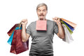 Surprised mature man holding shopping bags isolated on white background Stock Photo