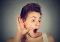 Surprised nosy man hand to ear gesture carefully listening gossip Royalty Free Stock Photo