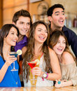 Surprised people at the club group of holding drinks Royalty Free Stock Photography