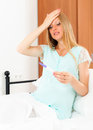 Surprised pregnant woman with pregnancy test at home interior Royalty Free Stock Images