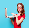 Surprised redhead girl with laptop Royalty Free Stock Photo