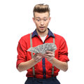 Surprised retro man holding money cheerful young caucasian in red vintage clothing isolated on white Royalty Free Stock Image