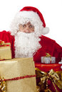 Surprised Santa Claus with Christmas gifts Royalty Free Stock Image