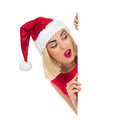 Surprised santa girl behind a placard blond christmas peeking studio portrait isolated on white Stock Photography