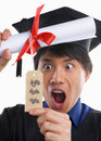 Surprised scholar in expensive education Royalty Free Stock Photo