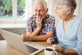 Surprised senior couple using laptop Royalty Free Stock Photo