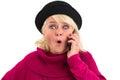 Surprised senior woman holding cellphone. Royalty Free Stock Photo