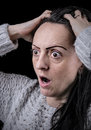 Surprised shocked woman looking scared black background with copy space Stock Photography