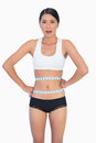 Surprised slim woman measuring her waist on white background Royalty Free Stock Image