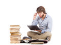 Surprised student young man studying with laptops and books Royalty Free Stock Photos