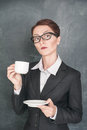 Surprised teacher in glasses with cup of coffee Stock Images