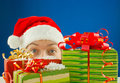 Surprised teen girl and Christmas presents Royalty Free Stock Photo