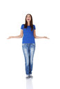 Surprised teen girl with outstretched arms. Royalty Free Stock Photos