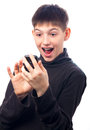 Surprised teenage boy looking at his smart phone Stock Photos